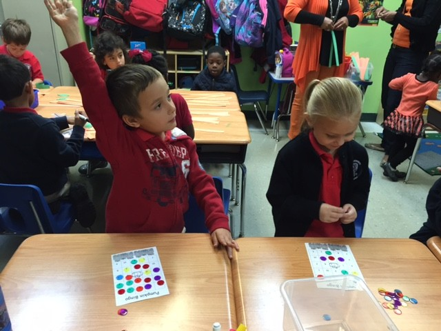 Fulton Science academy Fall center celebration fist