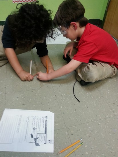 Fulton science academy private school exploring forces and motion in first grade